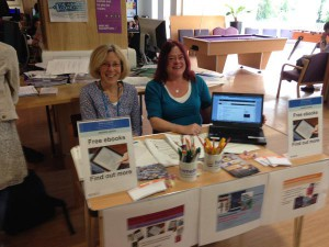 An image of Medical Library staff members Jo Milton and Sheila Palmer sitting at a table advertising an e-books drop-in session
