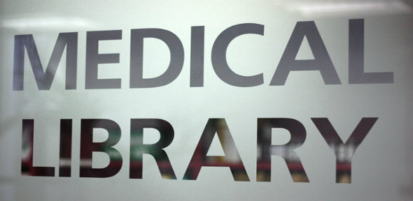 The words Medical Library etched into a glass panel in the Medical Library reception area