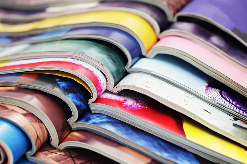 a photo of a pile of open magazines