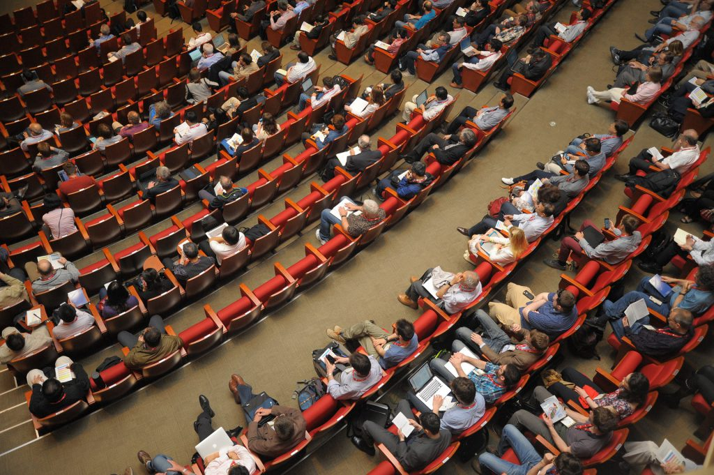 People in a conference auditorium